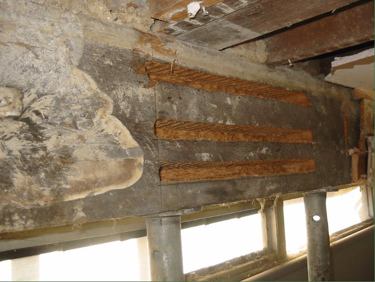 Horizontal slots cut into the beam